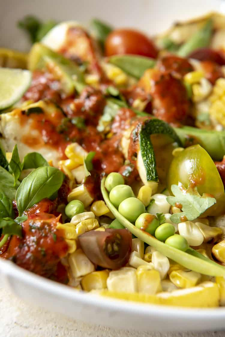 Closeup of Grilled Corn and Zucchini Salad with Red Pepper Vinaigrette