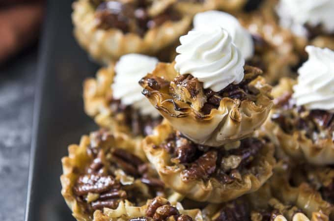 Mini Pecan Pie Tarts stacked on a plate