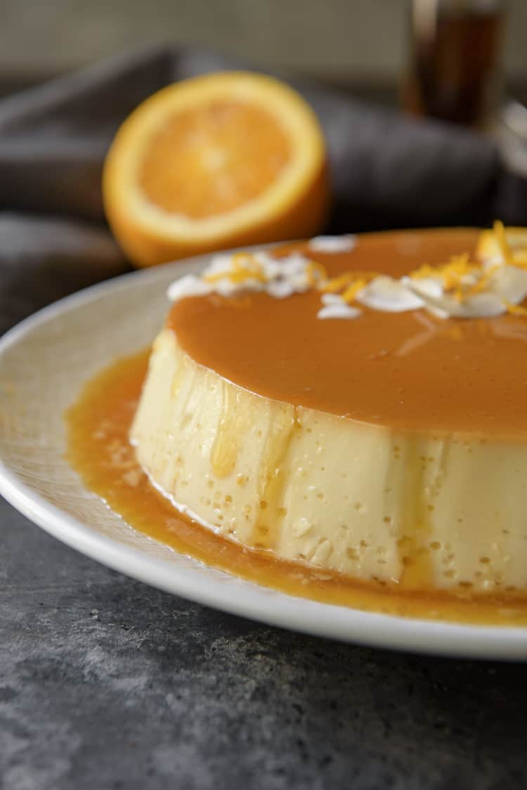Orange Coconut Flan with dripping caramel
