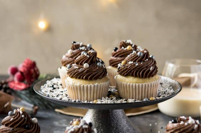 Chocolate Eggnog Cupcakes on a cake stand