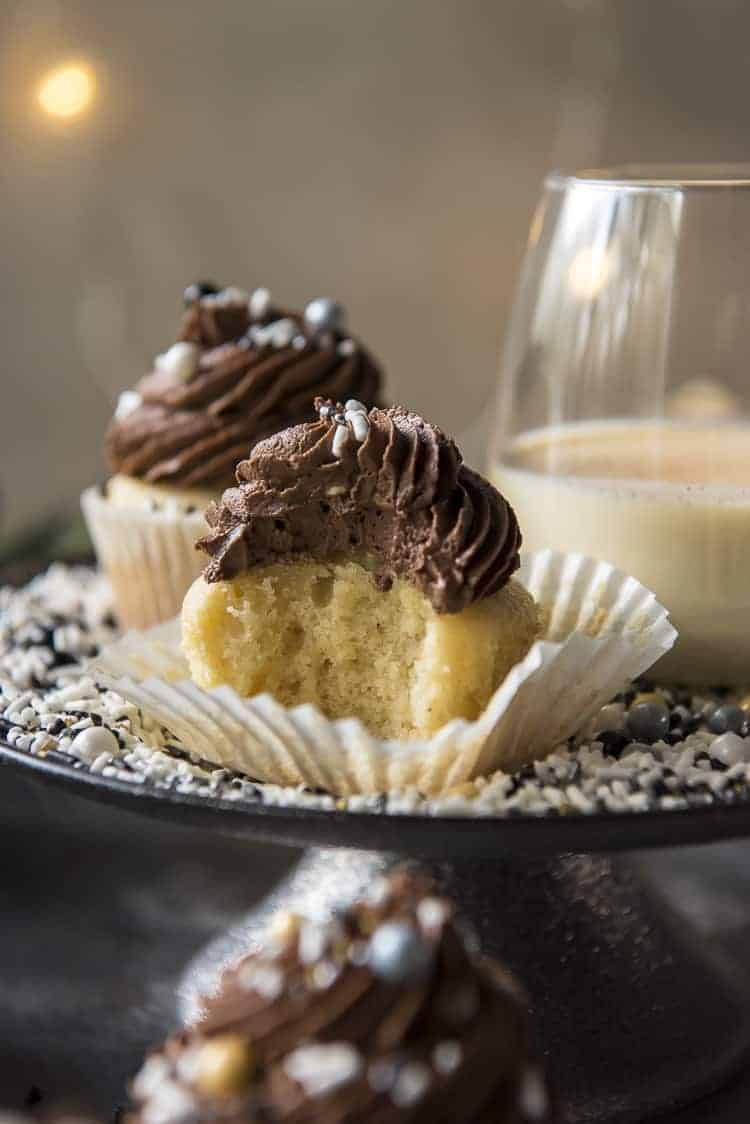 Chocolate Eggnog Cupcakes with a bite taken out of one