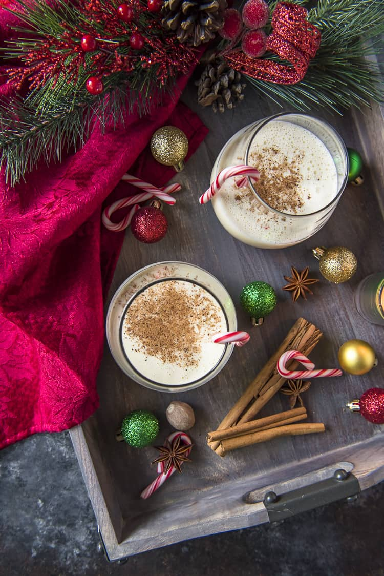 Top shot of Homemade Eggnog on a serving tray with Christmas decorations