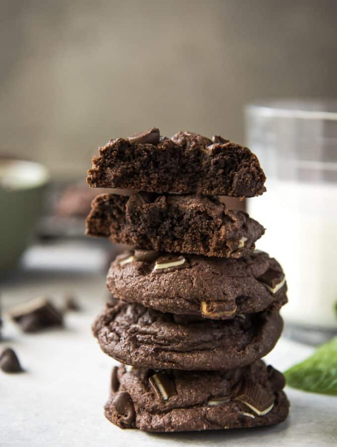 Stack of Mint Chocolate Chip Cake Mix Cookies with a broken cookie on top