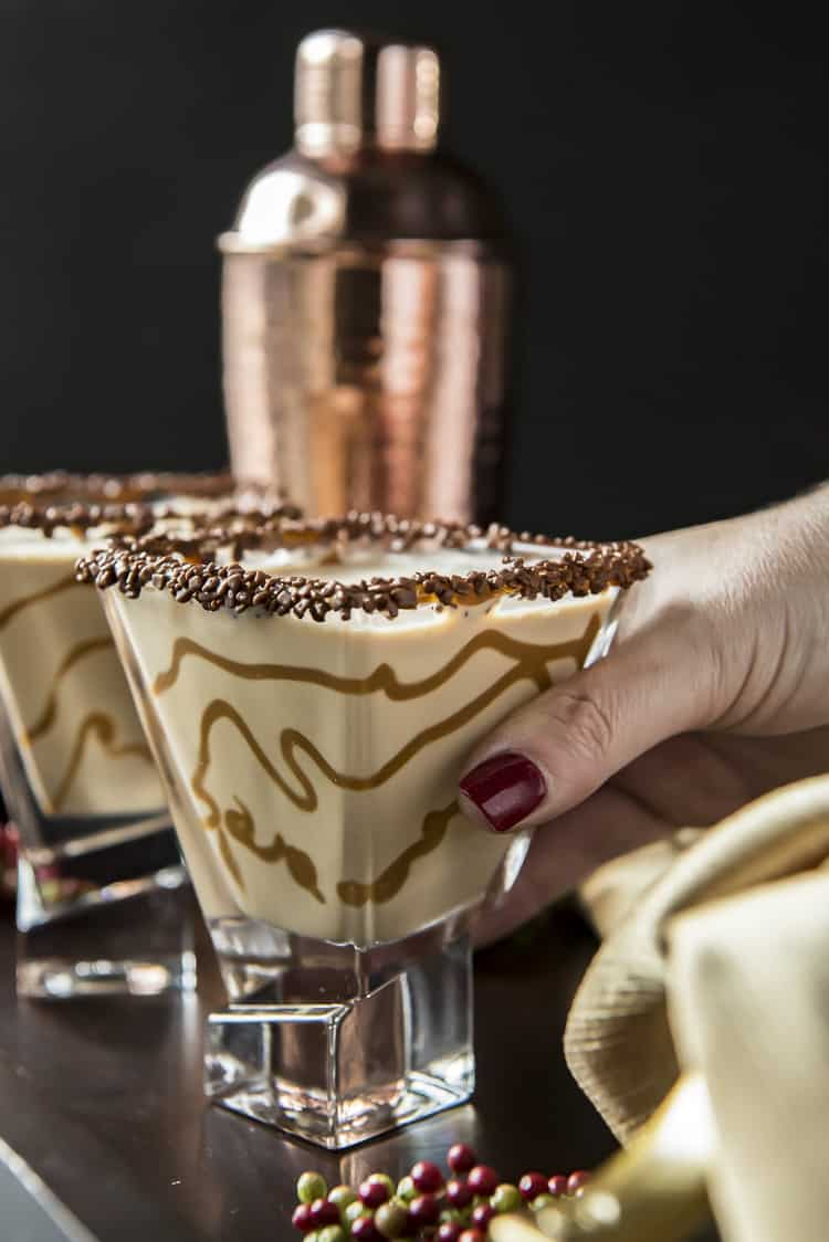Hand reaching for Salted Caramel Chocolate Martini