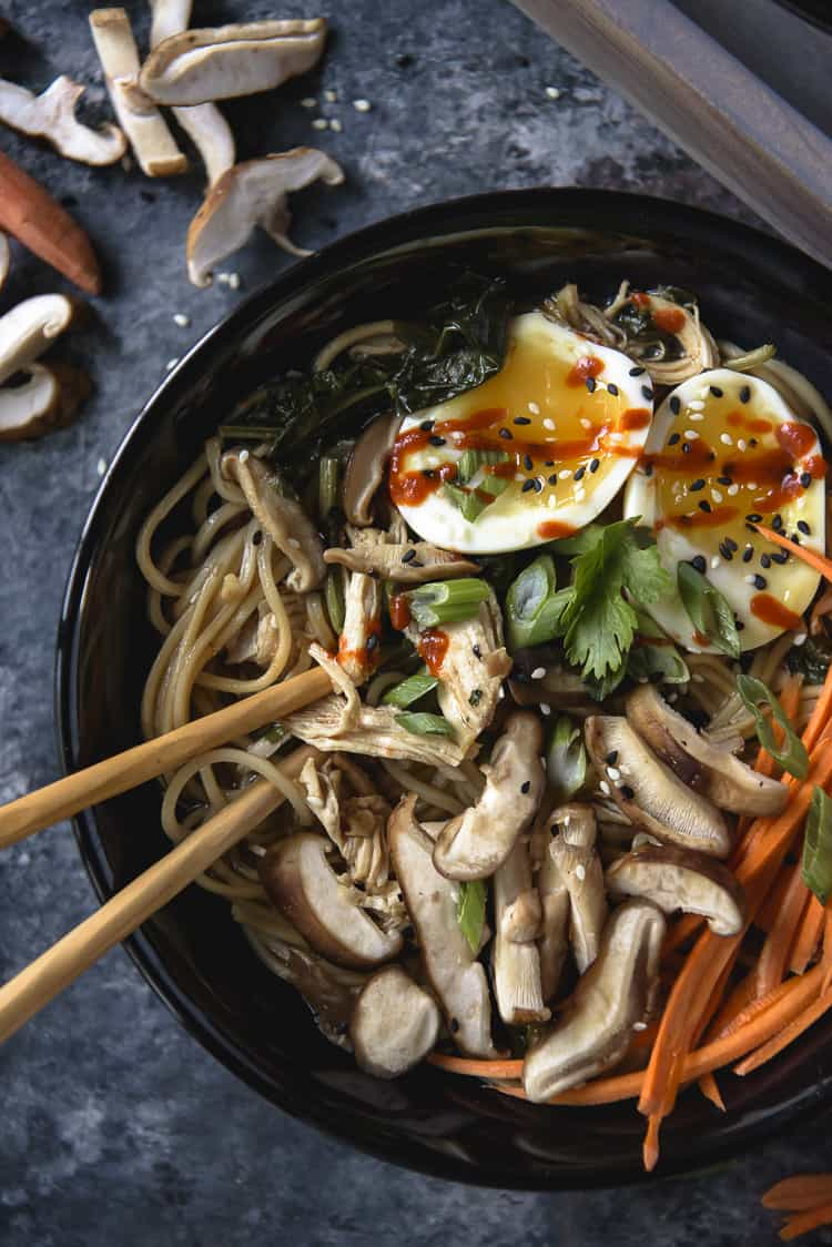 Chopsticks in a bowl of Instant Pot Shoyu Chicken Ramen