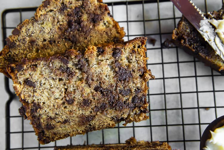 Slices of Moist Chocolate Chip Banana Bread on a cooling rack