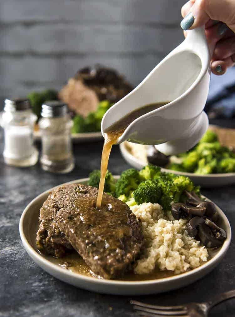 Pouring gravy over Slow Cooker Meatloaf
