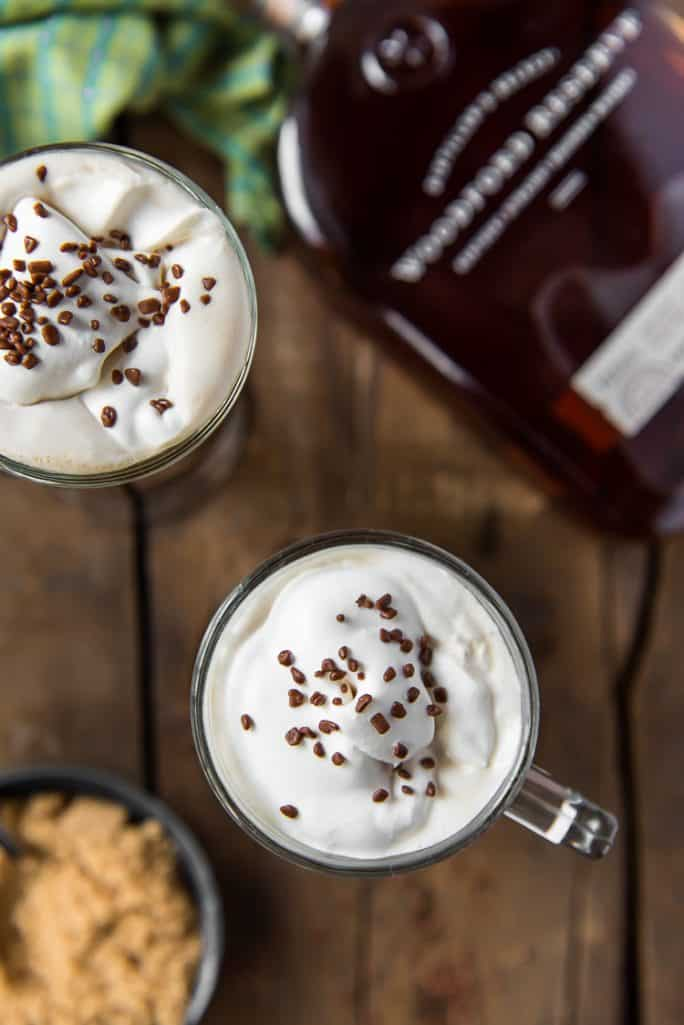 Classic Irish Coffees with a bottle of bourbon