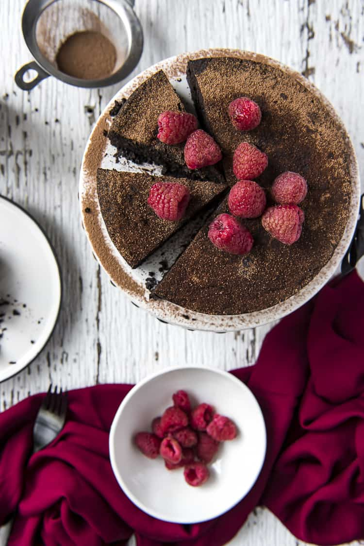 A Flourless Chocolate Espresso Cake with raspberries on top
