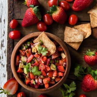 Fresh Tomato Salsa with Strawberries in a bowl served with cinnamon pita chips