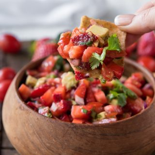 A scoop of Fresh Strawberry Tomato Salsa on a chip