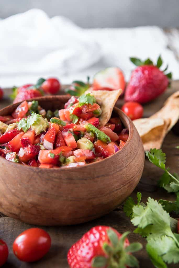 Fresh Strawberry Tomato Salsa with a chip in it