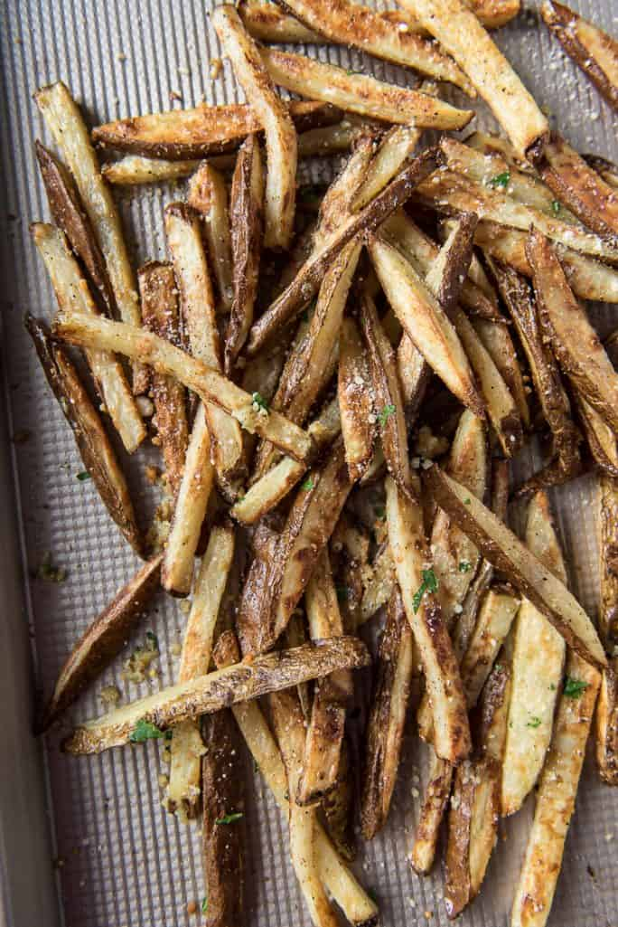 Baked Garlic Truffle Fries, tossed with Parmesan cheese and parsley