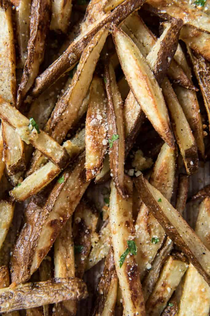 Closeup of baked garlic truffle fries with Parmesan