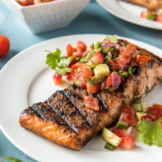 Grilled Salmon on a plate topped with Strawberry Salsa