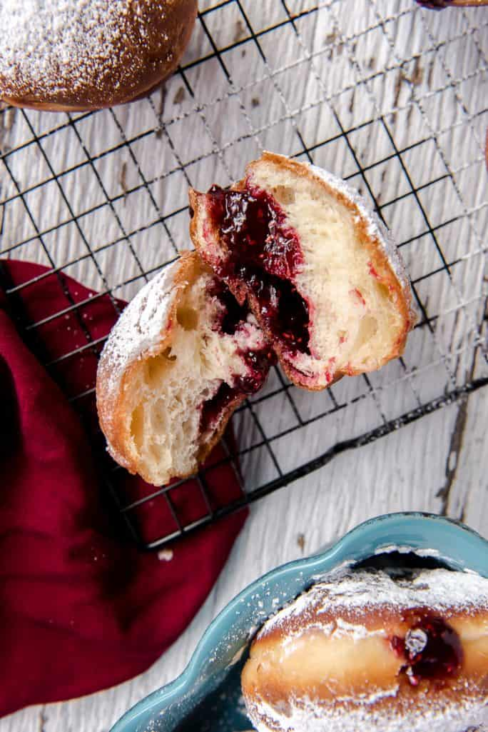 A Polish paczek donut cut in half