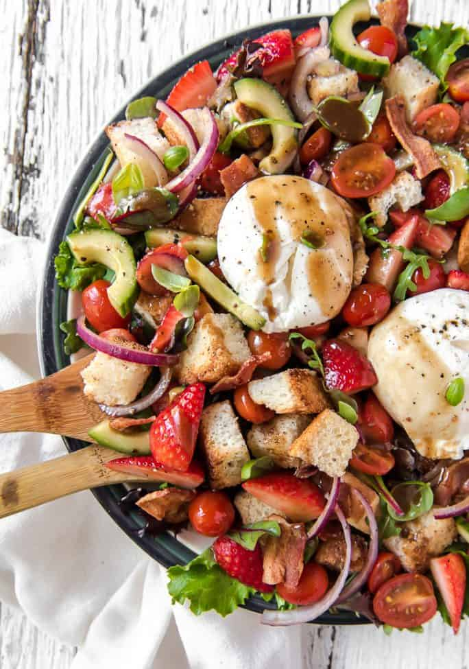 Strawberry Panzanella Salad with balsamic vinaigrette drizzled on