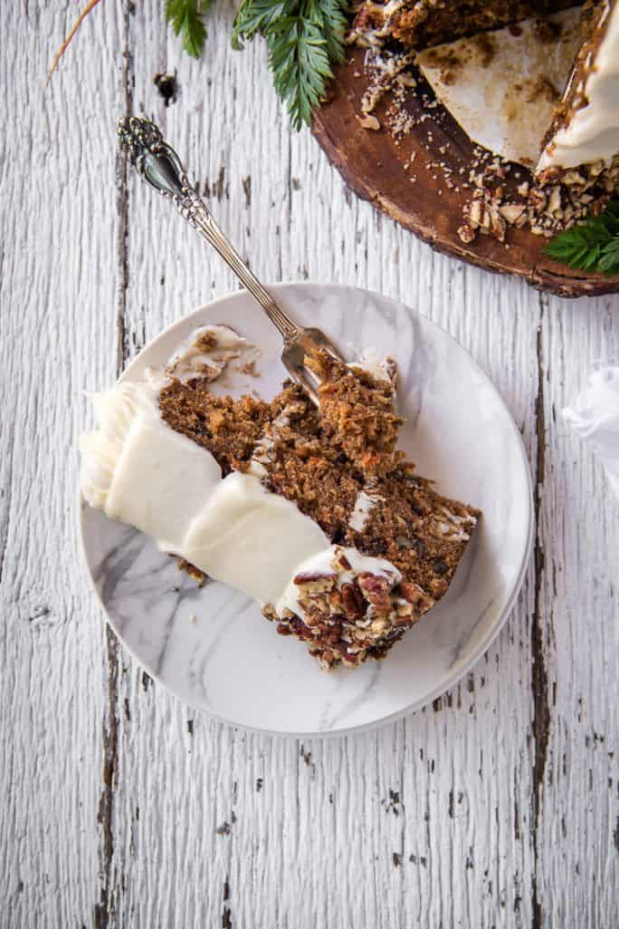 A slice of moist Buttermilk Carrot Cake on a plate with a fork