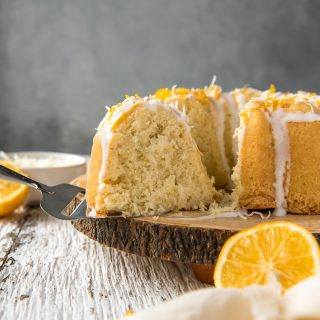 Cutting a slice of Coconut Lemon Pound Cake