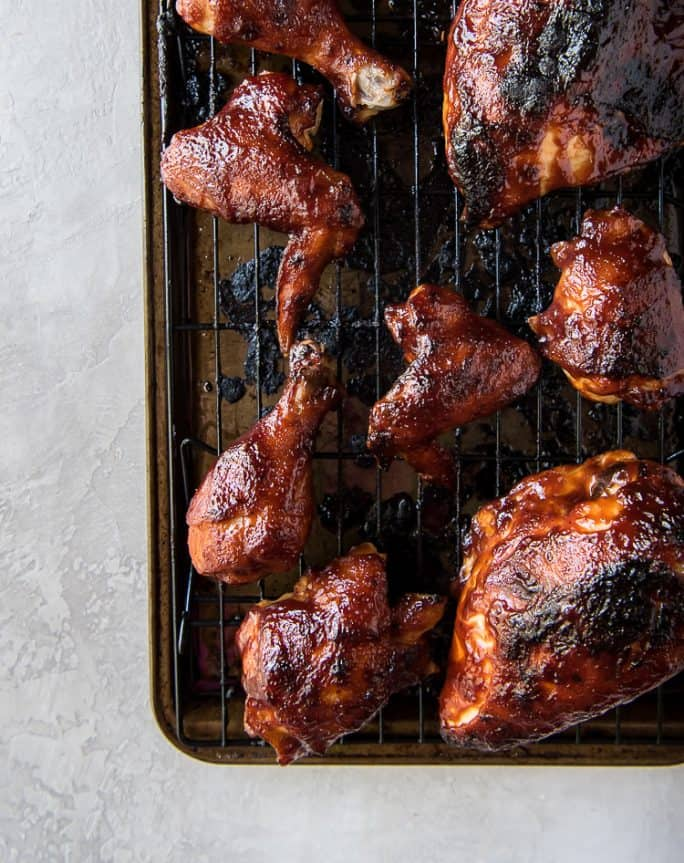 Baked BBQ Chicken Breast, Legs, Thighs, Wings on a pan, hot from the oven