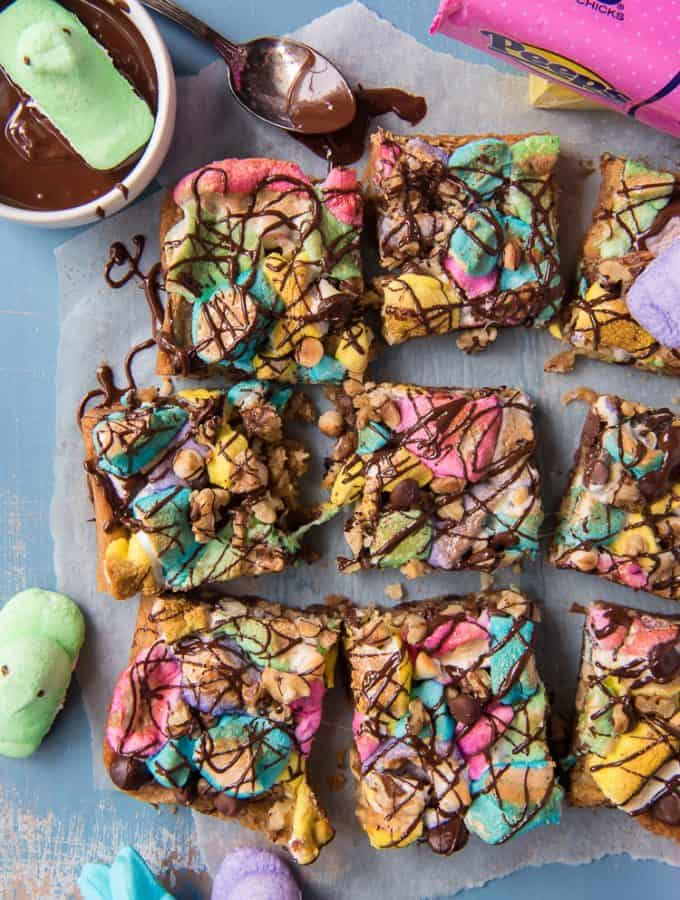 Springtime Rocky Road Blondies with a bowl of melted chocolate and marshmallow PEEPS