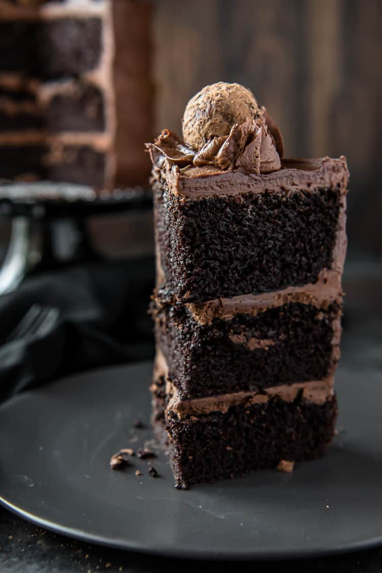 Slice of Triple Chocolate Cake on a black plate
