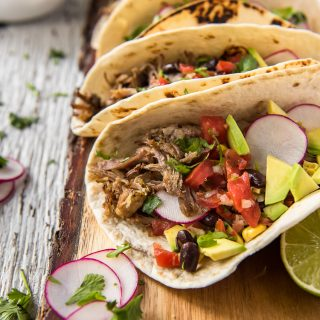 Instant Pot Carnitas Tacos on a cutting board