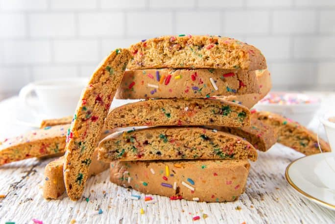 A stack of rainbow biscotti made with sprinkles