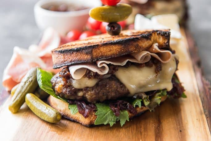 The Charcuterie Burger, loaded with cheeseboard favorites