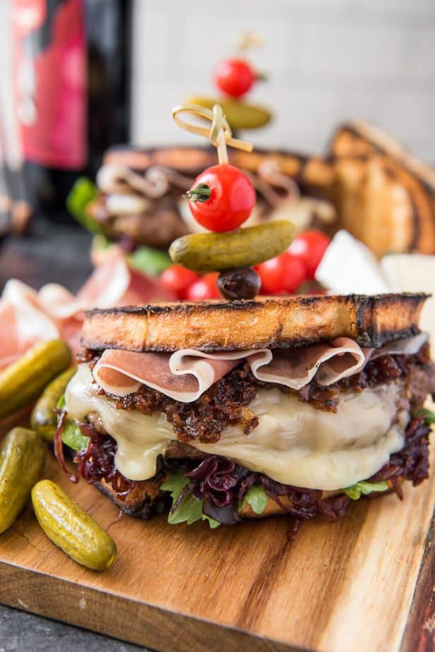 The Charcuterie Burger topped with a skewer of cheeseboard snacks