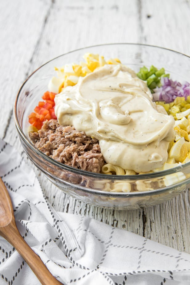Ingredients for Tuna Pasta Salad in a glass bowl