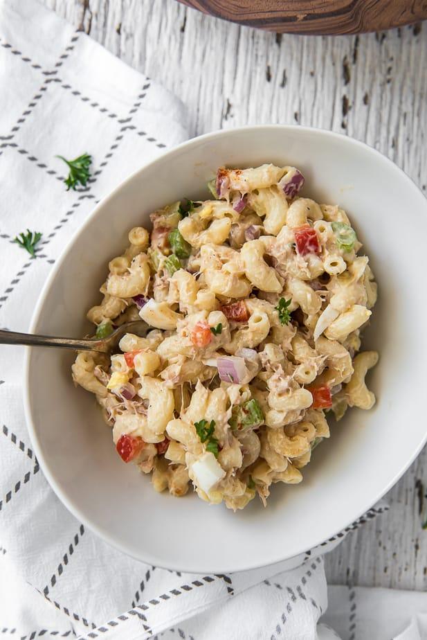Creamy tuna pasta salad in a white bowl