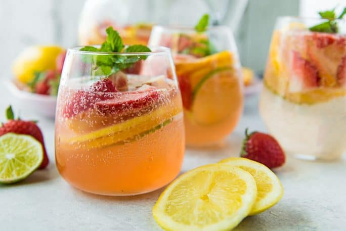 2 glasses of Easy White Sangria with sliced fruit