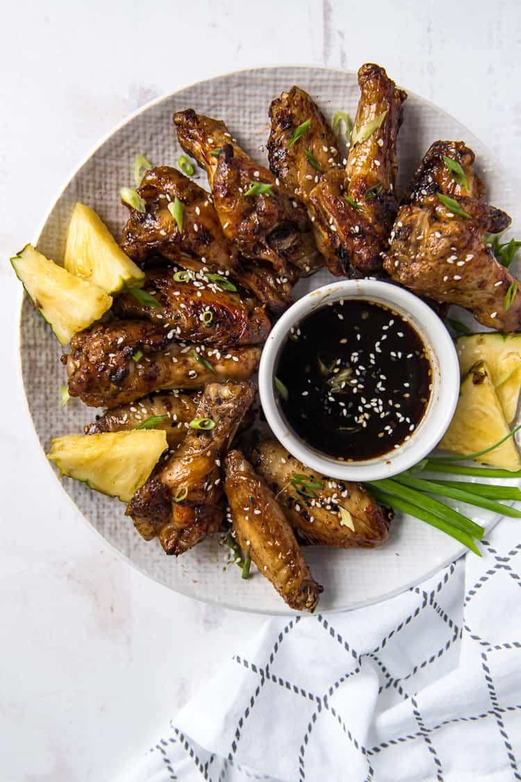 Air Fryer chicken wings tossed in Teriyaki sauce