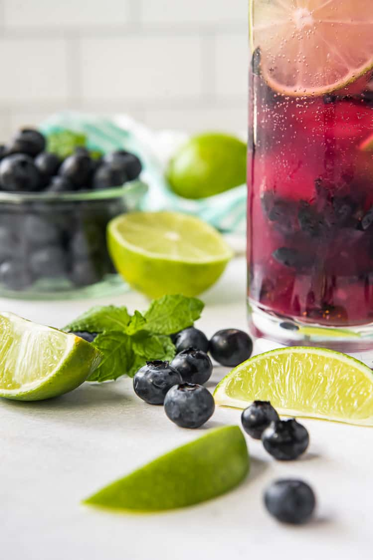 blueberries and limes on a table