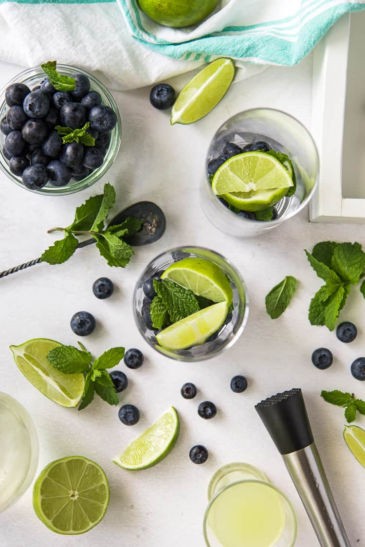 the process of muddling mojito ingredients