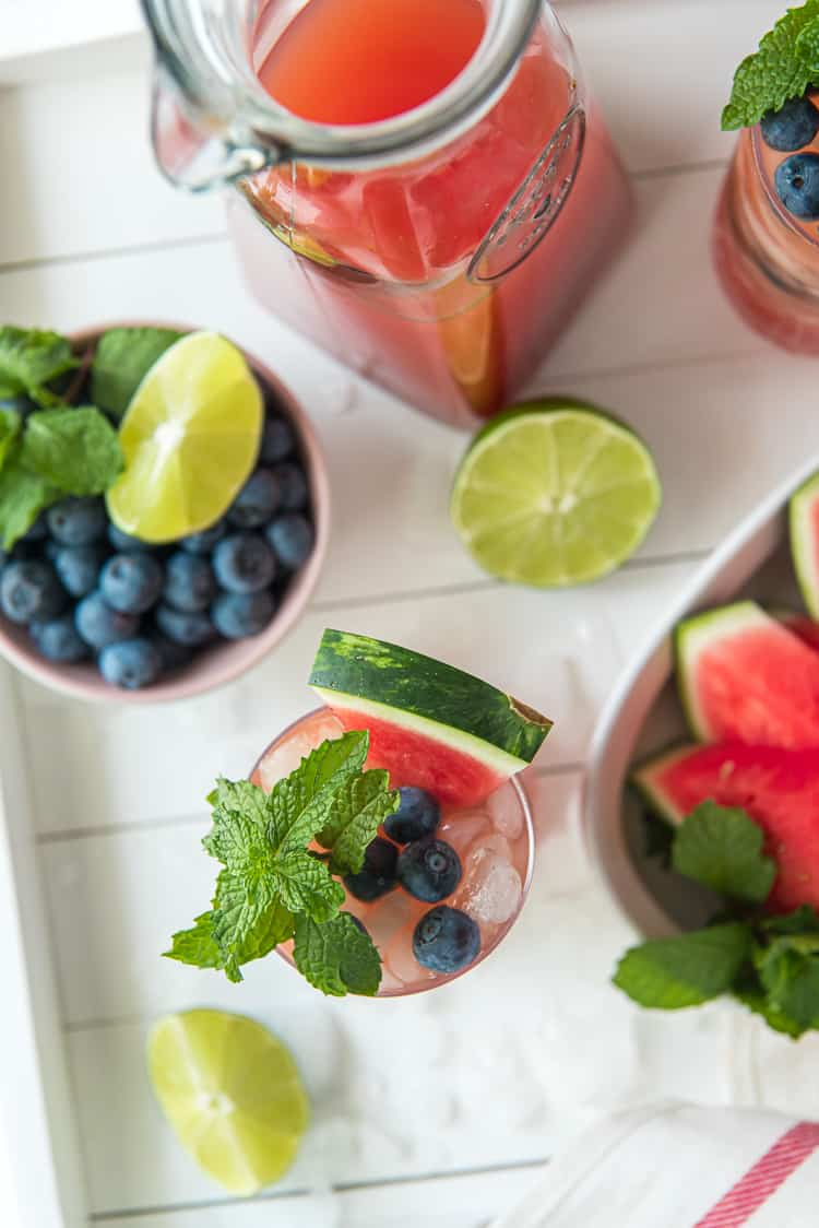 A top down shot of a tray of blueberry watermelon agua fresca