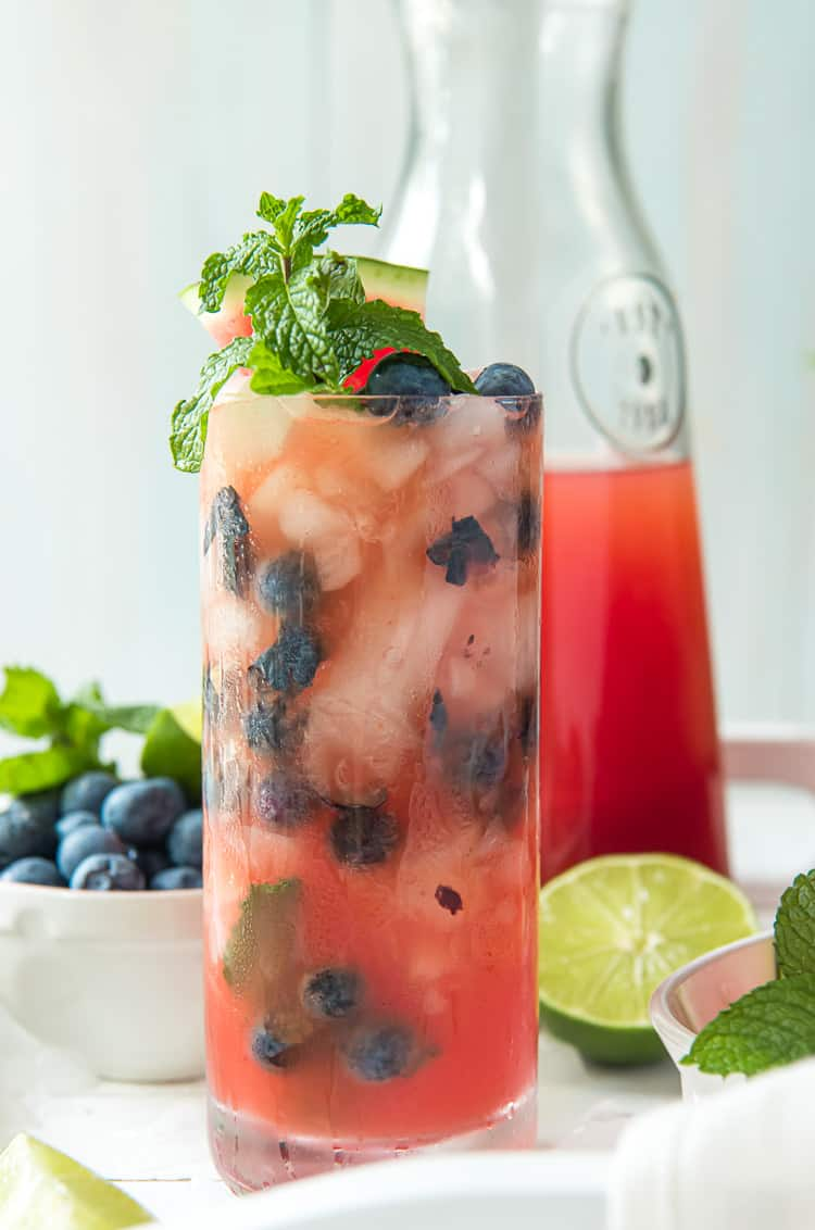 A glass of watermelon agua fresca with blueberries