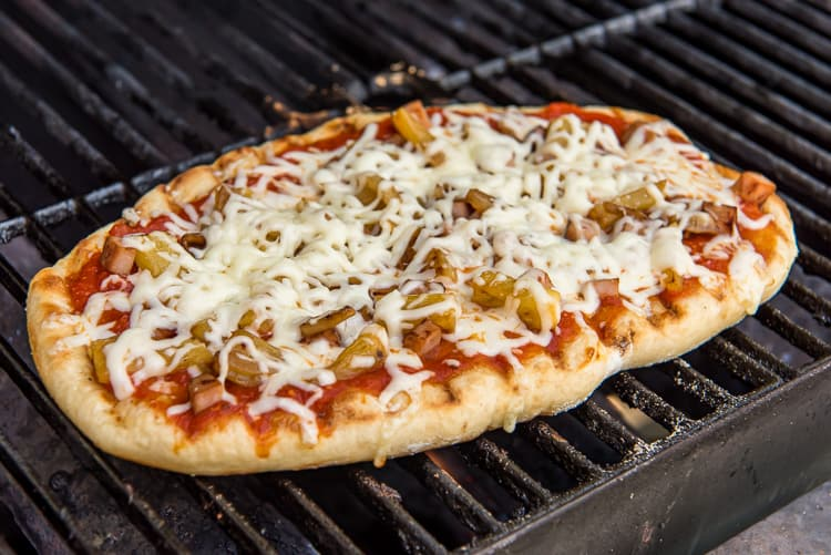 grilled pizza with Hawaiian-style toppings