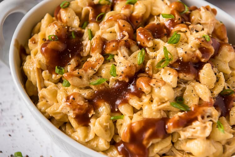 Closeup of barbecue chicken mac and cheese in a white serving dish