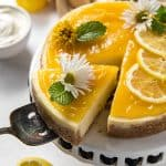 Pulling a slice from an Instant Pot Lemon Ricotta Cheesecake