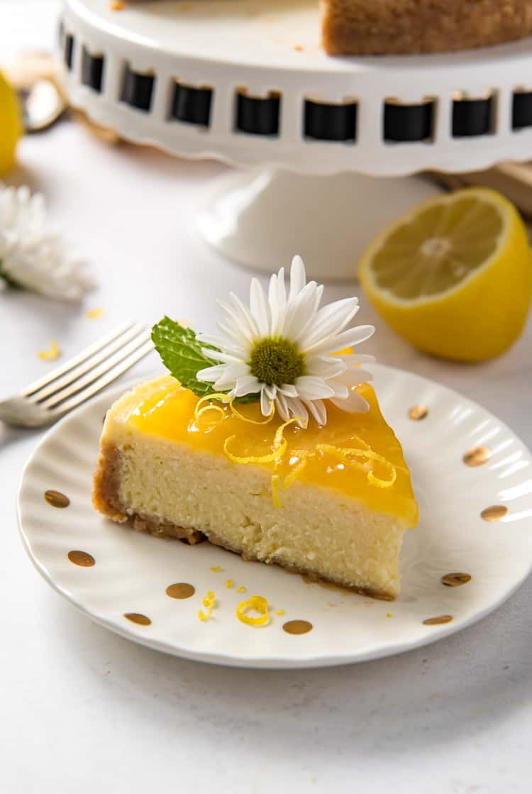 A slice of lemon ricotta cheesecake on a plate