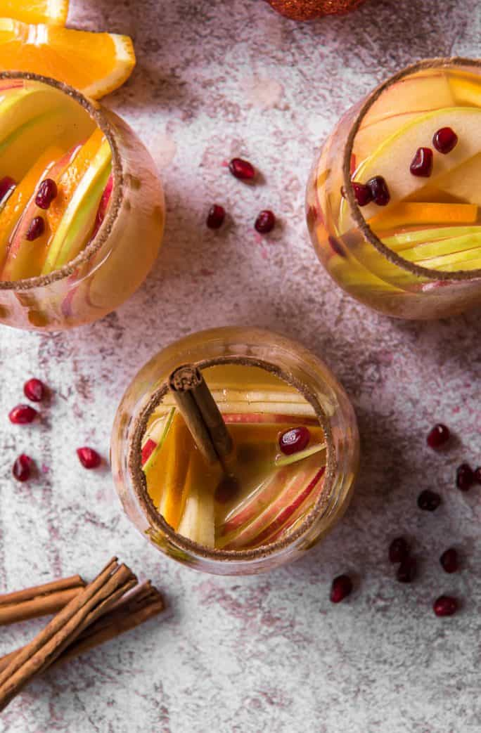 top shot of wine glasses filled with pumpkin party punch