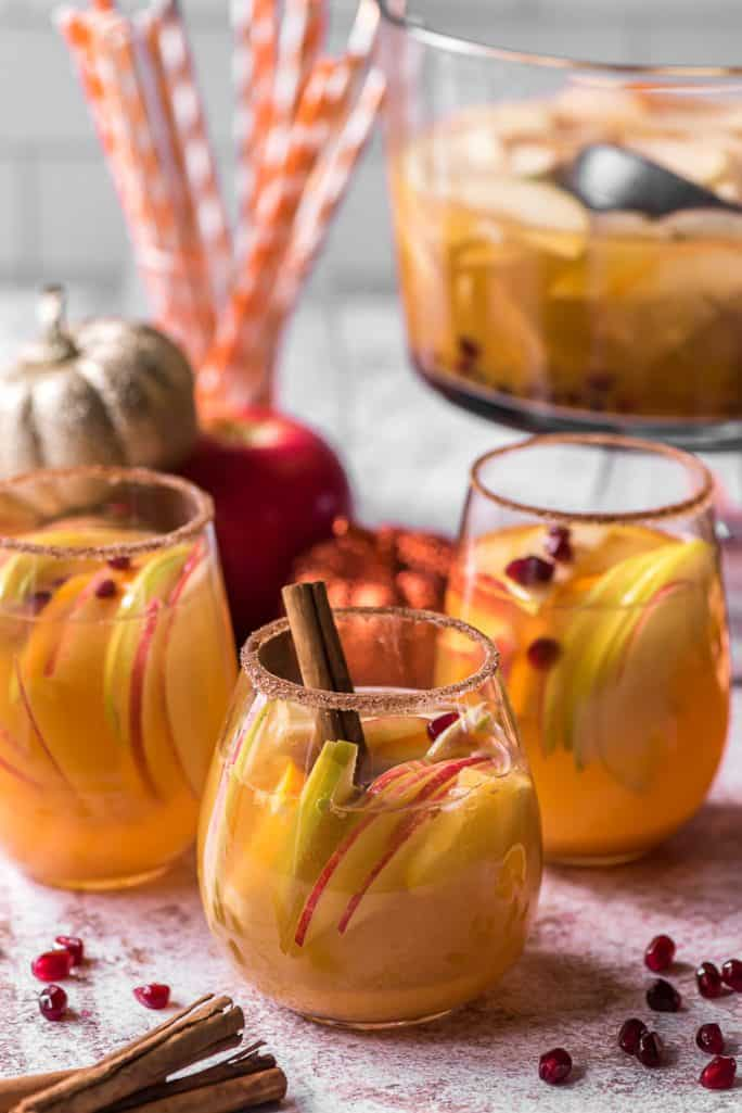 3 wine glasses filled with pumpkin party punch