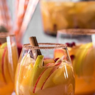 closeup of wine glasses filled with pumpkin sangria