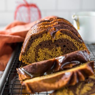 sliced swirl chocolate pumpkin bread with bourbon glaze drips