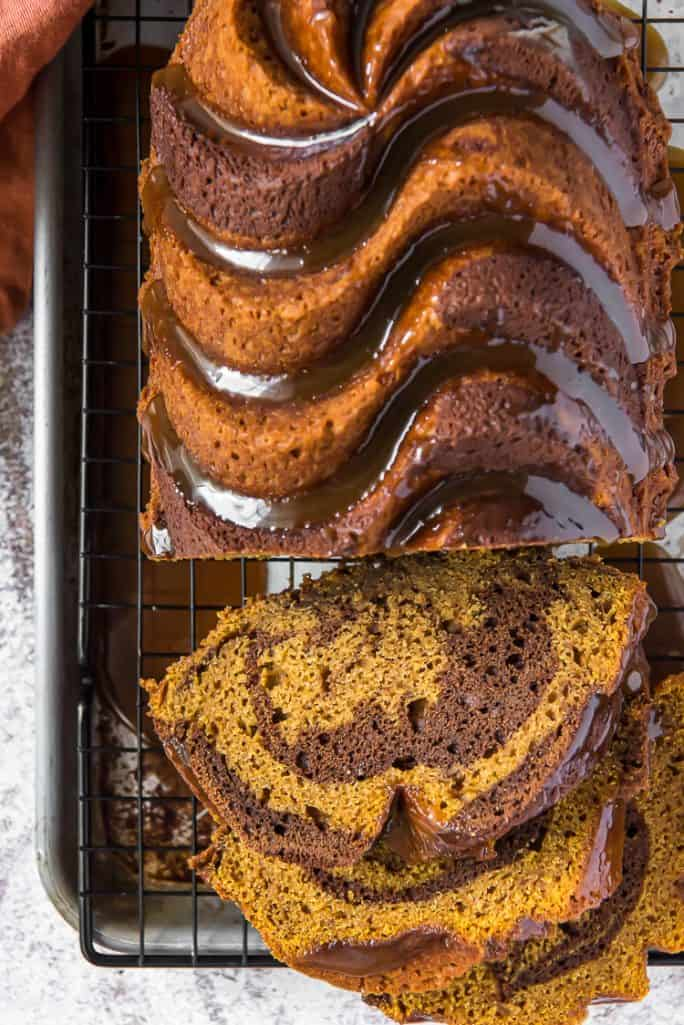 sliced swirl chocolate pumpkin bread on a cooling rack
