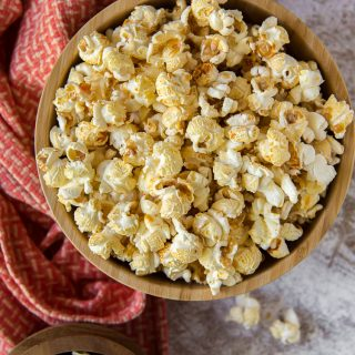 a wooden bowl full of homemade kettle corn